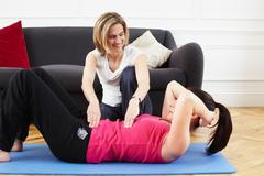Woman instructing a client. Pilates. Stock Photos