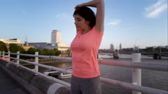 Female jogging in the bustling city - stock footage
