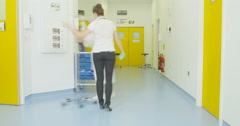 4K Time lapse of activity in hospital corridor, busy medical team at work Stock Footage