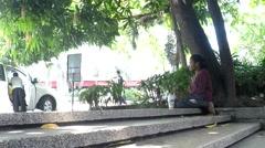 Woman beggar sitting seeking alms Stock Footage