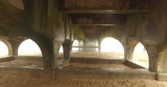 under pier looking out to sea heavy fog - stock footage