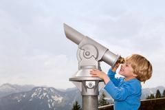 boy looking through telescope - stock photo