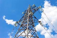 High voltage tower with ragged high-voltage line - stock photo