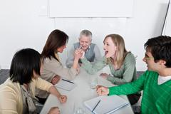 Arm wrestling in group meeting Stock Photos