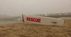 Life guard board heavy fog Stock Footage