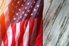 American flag in the sunlight. Stock Photos