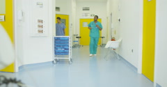 4K Staff & patients walking through busy area of the building in modern hospital Stock Footage