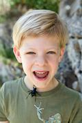 A portrait of a boy with a beetle Stock Photos