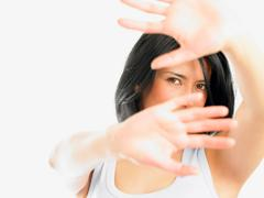Woman with hands in the way of the shot Stock Photos