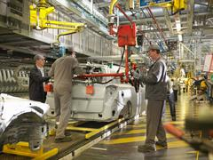 Car Plant Workers On Production Line Stock Photos