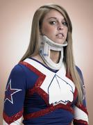 Cheerleader wearing a neck brace Kuvituskuvat