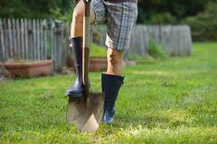 Gardener with spade - stock photo