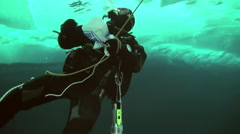 View the diver out of water on background of Arctic Ocean ice in North Pole. Stock Footage