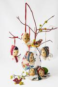 Folk easter eggs in vase like folk dolls Stock Photos