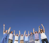 group of young people raising arms - stock photo
