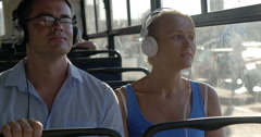 Bus commuting with music Stock Footage