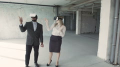 Businesspeople discussing interior of room in oculus rift - stock footage