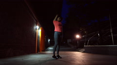 Female jogging in the bustling city at Night - stock footage