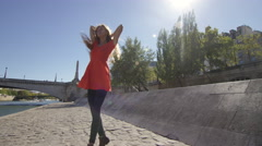 Yound Lady dances by the river in Paris Stock Footage