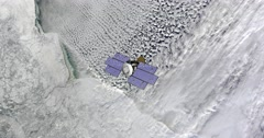 Top view of Earth-observing CloudSat spacecraft in orbit above Northern Canada. Stock Footage