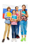 Whole-length picture of kids with Russian flag Stock Photos