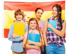 Four happy students standing with Spanish flag Stock Photos