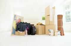 A room filled with packed belongings Stock Photos