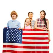 Happy American kids with the star-spangled banner Stock Photos