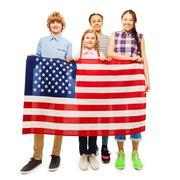 Happy teenage kids holding flag of United States Stock Photos