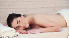 Girl lies on a massage table Stock Footage