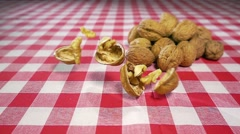 Walnuts falling on table slow motion Stock Footage
