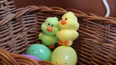 (Dolly Out) Easter Basket with Duck Candy and Matching East Eggs Stock Footage