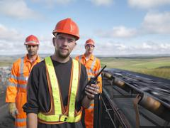 Coal Workers With Conveyor Belt Stock Photos