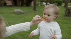 Child eating tangerine - stock footage