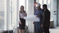 Architects discussing the interior and exterior - stock footage