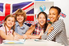 Happy teenage students at language courses - stock photo