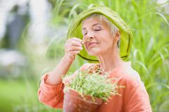 Woman in garden Stock Photos