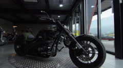 Shot of bespoke Harly in a modern Motorbike shop Stock Footage