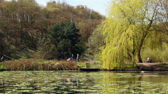 Moses Gate Country Park visitors walking by the lake at Bolton UK. Stock Footage