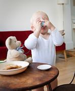 Boy toddler having a pretend cup of tea Stock Photos
