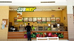 4K Subway restaurant, menu counter customer Stock Footage