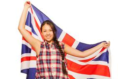 Asian teenage girl waving British flag behind her - stock photo