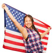 Asian teenage girl holds American flag behind her Stock Photos