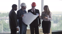 Architect and businessmen discussing project Stock Footage