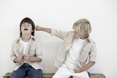 Young boys pretend fighting Stock Photos