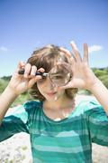 girl looking through a loupe - stock photo