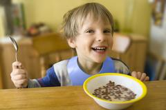 Boy Grinning at Breakfast Stock Photos