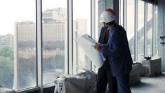 Architects talking standing near window Stock Footage