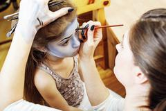 Little cute child making facepaint on birthday party, zombie Apocalypse Kuvituskuvat