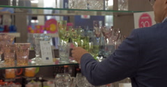 Man taking a shot of glass in the store Stock Footage